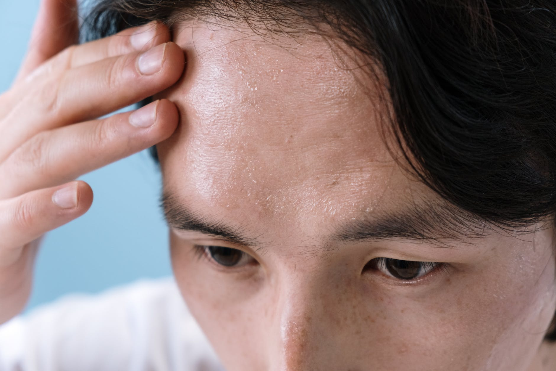 A man with a weak immune system displaying symptoms of headache